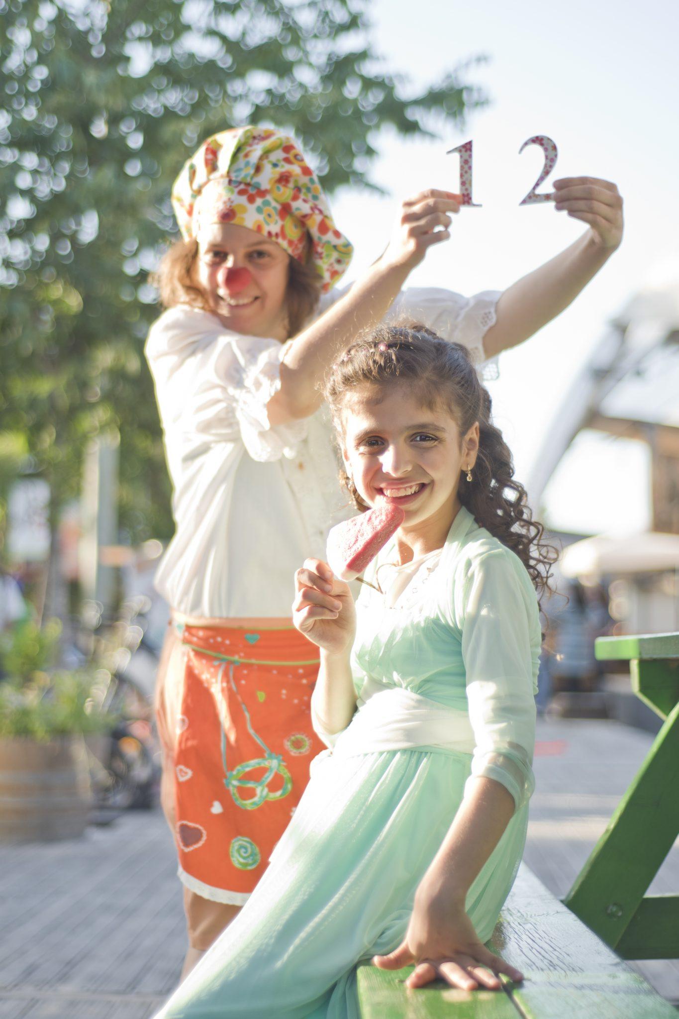 Racheli, 12 — photographing her bat mitzvah album